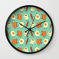 orange pattern Wall Clocks featuring Let's All Go And Have Breakfast by Teo Zirinis