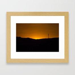 Sunset over the hills Framed Art Print