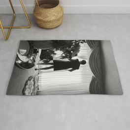 Woman Looking through the Window, A Rug