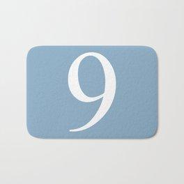 number nine sign on placid blue color background Bath Mat