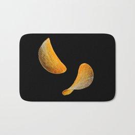 Potato chips on black background Bath Mat