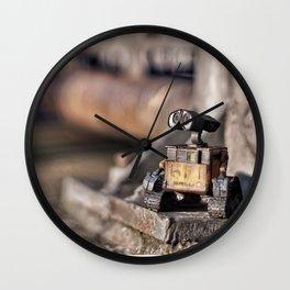 facing the sun Wall Clock