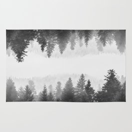 Black and white foggy mirrored forest Rug