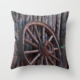 Old Wagon Wheel leaning up against a stick fence Throw Pillow