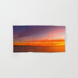 Orange sunset on a blue background of lake water Hand & Bath Towel