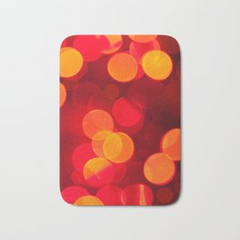 Red yellow sparkles and circles bokeh abstract Bath Mat