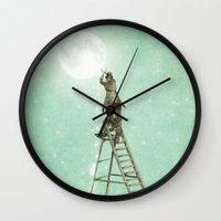 nan lawson Wall Clocks featuring Waning Moon by Eric Fan