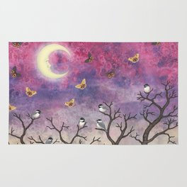 chickadees and io moths in the moonlit sky Rug