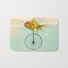 unicycle goldfish Bath Mat