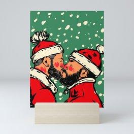 Christmas Kiss - Two Santa Clauses Kissing  plus snow  Mini Art Print