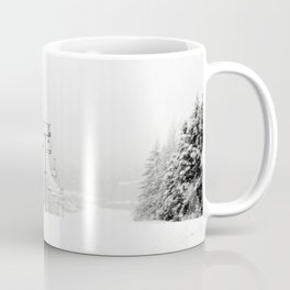 Lifts waiting for action in the snow Coffee Mug