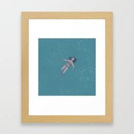 Girl Floating in the Ocean Framed Art Print