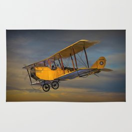 Yellow Biplane with Sunset Cloudy Sky Rug