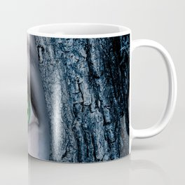 Big green eye in a blue tree Coffee Mug