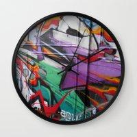 grafitti Wall Clocks featuring Grafitti by Anna Mundy