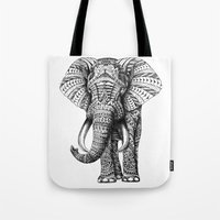 happy Tote Bags featuring Ornate Elephant by BIOWORKZ