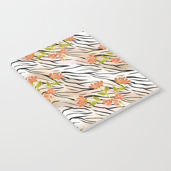 Floral pattern on a tiger background . Notebook