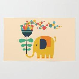 Elephant with giant flower Rug