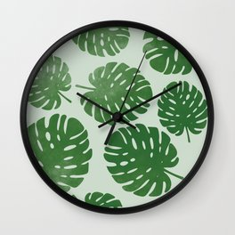 Palm leaves on light green Wall Clock