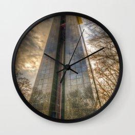 Black tower sunset Wall Clock