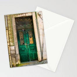 Old wooden door secured with chain and padlock. Wall with profusely decorated tiles. Stationery Cards