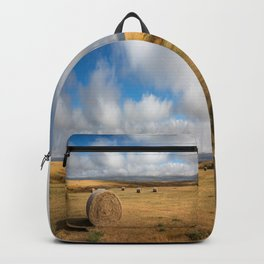 A Day on the Prairie - Round Hay Bales on Golden Landscape in South Dakota Backpack