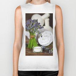 Fresh  lavender flowers, zen stones,Herbal massage balls , candle and towel over wooden surface Biker Tank
