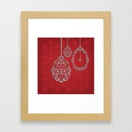 Silver lace hanging eggs on vibrant red background Framed Art Print