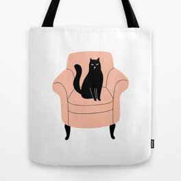 black cat on a chair Tote Bag