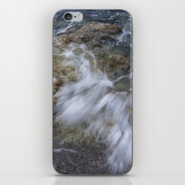 Crashing wave in a rocky beach iPhone Skin