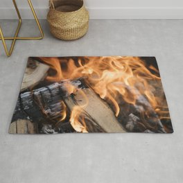 logs on the fire Rug