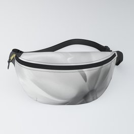 Close-up of white tulip in black background Fanny Pack