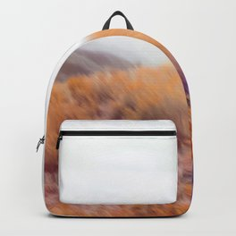 yellow flower field on the mountain with summer light bokeh abstract Backpack