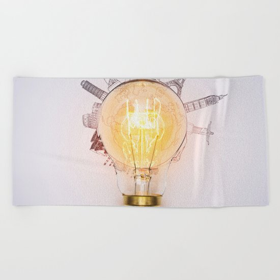 Light bulb with monuments Beach Towel