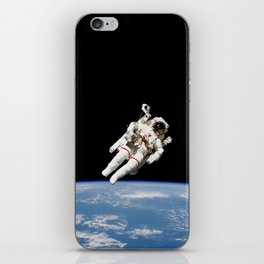 Astronaut Floating Free iPhone Skin