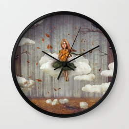 The little  girl sits on a cloud  in   autumn forest Wall Clock