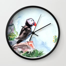 Atlanic Puffin sitting on the rocks by the ocean Wall Clock