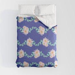 Watercolor flower garland on blue Comforters