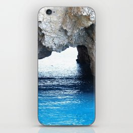 Rocks created a natural arch over crystal blue water iPhone Skin