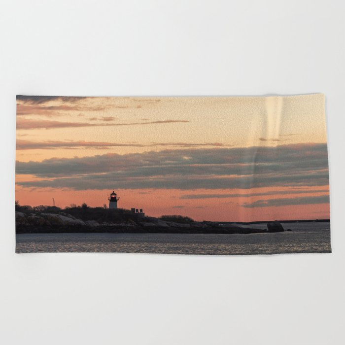 Painted sky over ten pound island light Beach Towel