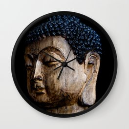 A Buddhist Statue in a Zen Moment with black background Wall Clock