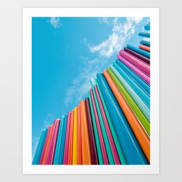 Colorful Rainbow Pipes Against Blue Sky Art Print