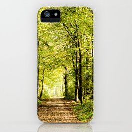 A pathway covered by leaves in a magical forest iPhone Case