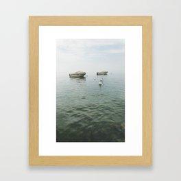 Boats in the lake Framed Art Print