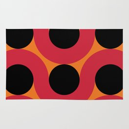 Black Balls on red Elastic Worms in an Orange Background Rug