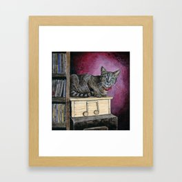 Brown Tabby Cat sitting on Music Box Framed Art Print