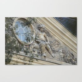 Baroque angel on Parisian mansion facade Canvas Print