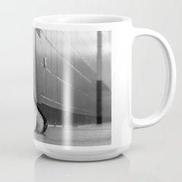 Black and white macro shot of hockey stick blades laid on a dirty arena floor Coffee Mug