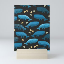Blue whales illustration with pattern of whales and yellow seashells on black background Mini Art Print