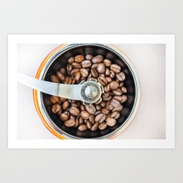 Roasted coffee beans in a manual coffee grinder. The view from the top. Art Print